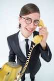 Smiling geeky businessman on the phone Stock Photography