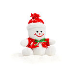 Smiling Generic Christmas Snowman Toy sitting on snow pile Stock Photo