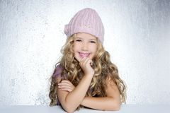 Smiling gesture little girl winter pink cap stock photography