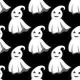 Smiling ghosts in white capes pattern Stock Photos