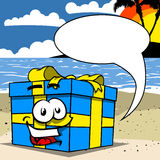 Smiling Gift box with speech bubble in tropical environment Royalty Free Stock Image