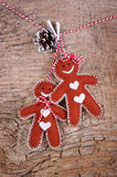 Smiling gingerbread boy and girl Royalty Free Stock Image