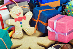 Smiling gingerbread man and Christmas decorations. For the holiday Royalty Free Stock Photo