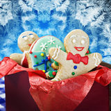 Smiling gingerbread man cookies. And the rest in a gift box Stock Images