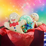 Smiling gingerbread man cookies. And the rest in a gift box Royalty Free Stock Images