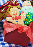 Smiling gingerbread man cookies. And the rest in a gift box Royalty Free Stock Photos