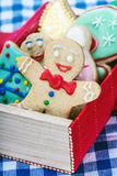 Smiling gingerbread man cookies. And the rest in a gift box Stock Photography