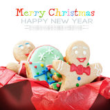 Smiling gingerbread man cookies. And the rest in a gift box on a white background. delete text Royalty Free Stock Photo