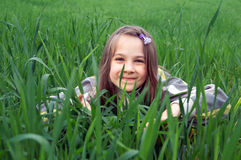 Smiling girl. Girl lying on meadow in the grass Stock Photo
