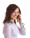 Smiling girl. Cute young smiling brunette girl speaking over the cellphone. Isolated on white Stock Images