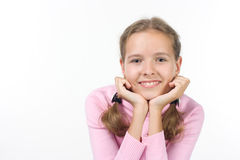 Smiling girl. In a pink sweater Royalty Free Stock Image