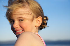 Smiling girl. A funny little blond girl making a smiling face with her mouth open royalty free stock photo