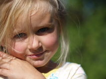Smiling girl. Little girl that is smiling and shame royalty free stock photos