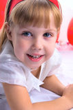 Smiling girl. Closeup of cute smiling girl with red hair band Royalty Free Stock Images