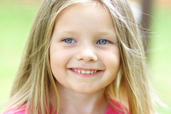 Smiling girl. A young girl smiling whle playing outside Stock Photos