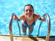Smiling girl. Is going to come out of water-pool royalty free stock images