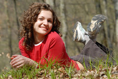 Smiling girl. Is lying in the forest stock photography