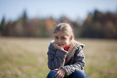 Smiling girl. On a lawn. Portrait Royalty Free Stock Photography