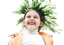 Smiling girl. With a wreath of grass on his head Stock Image