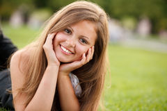 Smiling girl. Young pretty girl smiling looking at camera Stock Images