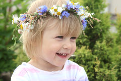 Smiling girl. Portrait of smiling 2-3 years old girl with flower crown on her head Stock Photos