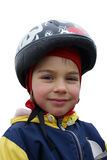 Smiling girl. In a helmet. Isolated royalty free stock photography