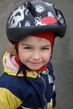 Smiling girl. In a helmet stock image