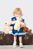 Smiling girl 4 years old with teddies Stock Photos