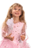 Smiling girl. A smiling girl is in a pink dress Stock Image