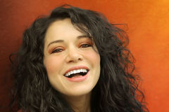 Smiling Girl. Young curly haired woman with big smile Stock Photo