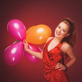 Smiling girl with air balloons Royalty Free Stock Photos