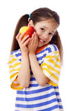 Smiling girl with apple Royalty Free Stock Image