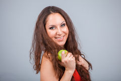Smiling Girl and apple Royalty Free Stock Images