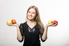 Smiling girl with apples. Smiling girl holds apples and smiles Royalty Free Stock Images