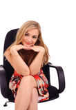 Smiling girl in armchair Royalty Free Stock Images