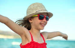 Smiling girl with arms wide open. Royalty Free Stock Photos