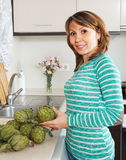 Smiling girl with artichoke Stock Photography