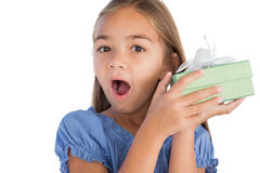 Smiling girl astonished while holding a present Royalty Free Stock Photography