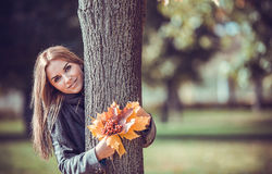 Smiling girl with autumn bouquet Stock Image
