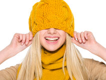 Smiling girl in autumn clothes with hat over head Royalty Free Stock Photos