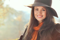 Smiling girl in autumn clothing Royalty Free Stock Photos