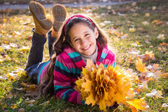 Smiling girl with autumn leaves Royalty Free Stock Photos