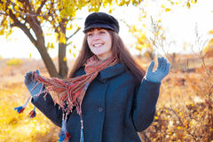 Smiling girl in autumn Stock Images