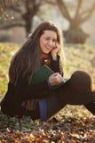 Smiling girl autumn outdoor Royalty Free Stock Photos