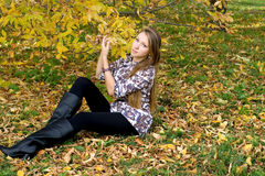 Smiling girl in autumn park Royalty Free Stock Images