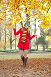Smiling girl in autumn park Stock Image