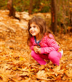 Smiling girl in autumn park Stock Photography