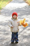 A smiling girl in autumn park Stock Images