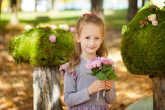Smiling girl in the autumn park Royalty Free Stock Images
