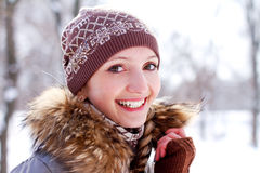 Smiling girl on a background of a winter park Royalty Free Stock Photos